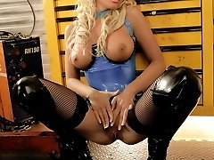 Beauty blonde wears blue latex body