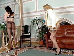 Curious gal spying upon stunning babe putting on extremely seductive tights