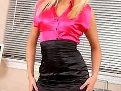 Beautiful blonde Natasha Marley in sexy secretary outfit.