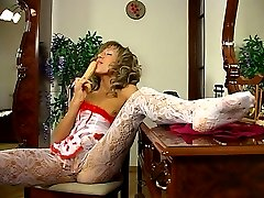 Leggy sexpot gets hot from the feel of her burgundy and white lacy tights
