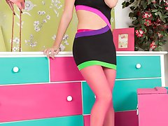 Sexy blonde babe Vanessa parades and teases in colourful ensemble featuring some gorgeous sheer...