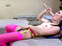 Ponytailed doll in bright pink girlie nylons stuffs an oversized rubber toy