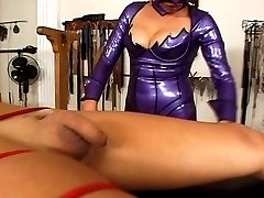 Tranny gets tied to a large leather pad and held upside down until other slaves arrive
