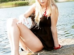 Blonde bimbo shows panty up skirt