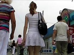 Girl wearing tan pantyhose up skirt