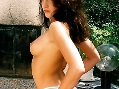 Brown haired cutie babe stripping her sexy red dress and rubbing pussy outdoors