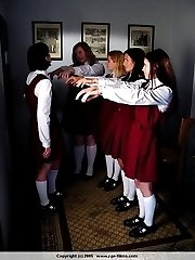 Four school girls in tears - stripped naked and tied over a bench - deep crimson cane stripes