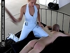 Guy stripped naked and tied face down on the bed - searing wooden paddling from strict miss