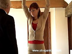 Ass cheeks spread wide showing her asshole and cunt during severe caning - streaming tears