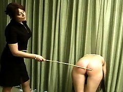 Mistress gives her a hard caning, making the young girl whine in pain. The second students is next. Let's see if she can take it what she just watched.