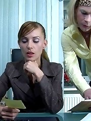 Strapon-armed female eagerly filling the mouth and ass of the office sissy
