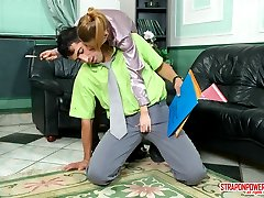 Kinky gal shows her real nature to her co-worker in strap-on fucking action