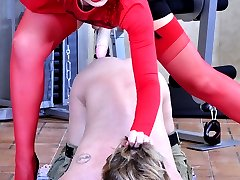Red hot babe pushes a poor guy�s pants down for some rough strapon abuse