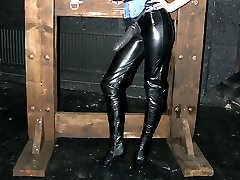Jane posing in her dungeon cage waiting for her next slave