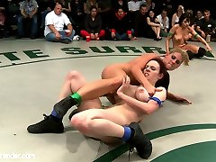 Welcome to Tag Team Tuesdays: totally non-scripted, all in front of a live audience, all broadcast live to members. Today's update is RD 2 of 4. This was March's live match, now edited for your enjoyment!   This is a close, tough match, basically a tie going into rd 2. Beretta tries to change that, getting her fingers into Shae's pussy. Charisma can't dominate Iona the same way. Iona shows she's learned a thing or two about wrestling, not to mention pussy licking, and gives our college athlete a real workout.   By the time Beretta returns to the mat, the Blue team has opened a big lead. Shae is fingered and brutally dominated and team Blue's lead evaporates. Expertly using their tags, Beretta and Charisma double up again on poor Shae.   With time running out Iona returns to the mat. Her team has fallen behind, can she cut team Green's lead before the end of the round?