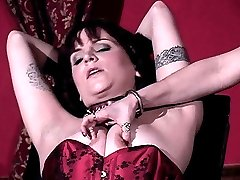 Sexy dominatrix Mistress Erzsebet punishes her naughty submissive partner with painful nipple...