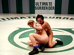 Darling is an experienced Ultimate Surrender wrestler who trains multiple disciplines when she's not on our mats. Adrianna Luna is an experienced MMA fighter with big dreams of showing porn sluts how real MMA fighters bang it out! Little does Adrianna know that Darling trains more than your average porn slut and knows our rules inside and out. Darling uses her mouthpiece to do some of the most memorable on-the-mat trash talking we've ever heard from her. It's clear she really enjoyed dominating this particular gal especially since Darling sways away from her tried and true technique of catch and release before the 1:30 mark. In this match we get some rare submissions done by our Grappler, Darling. She hardly ever goes for submissions but she had something to prove today. She pulled out all the stops against this MMA babe. This match isn't even close. Darling even finds a new ways to score style points in making her opponent worship her muscle while she immobilizes her.  As if submitting to muscle domination and losing at a competitive wrestling match to a