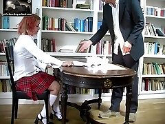 School teen bent over for a caning in the library - well striped buttocks