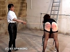 Big buxom ass gets paddled and caned in the outhouse - severe punishments