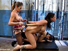 Felony has her way with two lovely brunettes pushing them to their limits and using them as sexual objects for her own amusement. Welcome Bryn Blayne and Brandy Aniston to Whipped Ass! Felony ties them cleverly face to face one on top of each other taunting them with flogging, caning, hot wax, evil nipple and pussy torture where one movement from the other will inflict beautiful pain to their friend. Felony rewards them with her delicious pussy nectar and commands Brandy worship her ass. They are both fucked simultaneously in the pussy and then strap-on fucked deep in their asses and made to lick each others dildos clean!Such dirty little obedient lesbian whores!