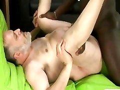 Big daddy bear gets a big black cock