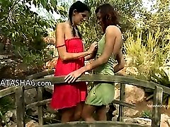 lovely girls licking pussies outdoors