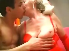 Granny fucks young guy with strapon