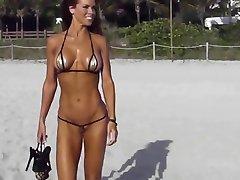 Extreme short bikini cameltoe string on beach