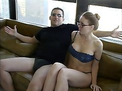 Lovely babe in glasses and lingerie gets fucked and facialized on a couch