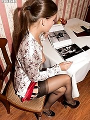 Czech babe Simona browsing sexy photos in her black nylons and fetish heels!