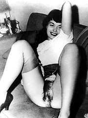 Ladies try stockings on and play with each other