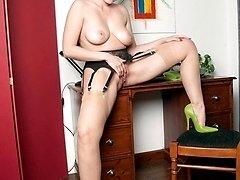Sophia is geting her admin done stripping down to her black longline bra and sheer panites!
