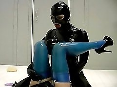 Agile slave getting dildo-fucked upside down right on the floor by her catlike latex mistress