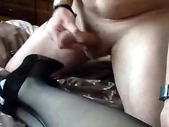 Cumming on her black patent shoes and nylons