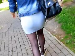 Tight miniskirt and Black pantyhose.