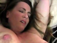 Delicious mommy with swinging tits