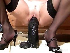 Amateur milf fucking huge dildos in her snatch