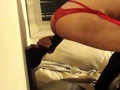crossdresser playing with black dildo