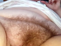 rubbing her soft chubby hairy pussy mound