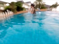 Pretty Asian Girl Swimming and Diving Underwater