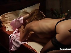 Mistress in Corset Whipping Slave