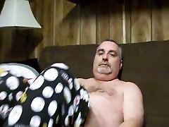 Sexy bear wanking on sofa