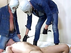 Two masters in gas masks facesitting on a slave 2