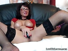 Busty mature masturbates with sex toys on webcam
