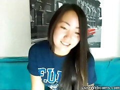 Cute Asian babe gets naked on webcam