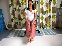 teacher sitting in a chair showing how to relax your toes at home