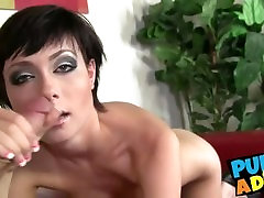 Short haired beauty plays with her pussy