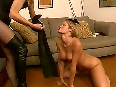 Lesbian gets naked and licks Dominatrixs high-heel boots