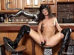 Skinny Sarah Moon in high boots dildos her twat