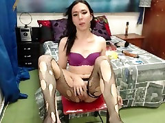 Shemale toys with her cock while smoking